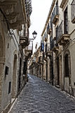Streets in Syracuse. Typical old, narrow and dirty streets in Syracuse in Sicily, Italy Royalty Free Stock Photos