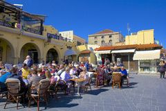 Streets and tavernas of Rhodes town, Greece. Street and tavernas in old Rhodes town, Greece royalty free stock images
