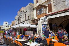 Streets and tavernas of Rhodes town, Greece. Street and tavernas in old Rhodes town, Greece royalty free stock photography