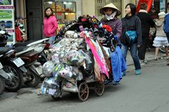 Streets of Vietnam - Clothing and accessories seller Stock Images
