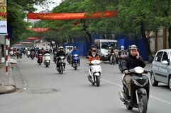 Streets of Vietnam - Hanoi traffic with scooters Stock Photo