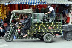 Streets of Vietnam with motorized rickshaw - Hanoi market Stock Image