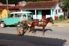 The streets of Vinales cuba. A cow boy riding a horse on the streets of Viñales Cuba Royalty Free Stock Photo