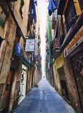 On those Streets. Walking around the Gothic quartier in Barcelona, Spain. Perspective view of a lonely man walking along his way Royalty Free Stock Images