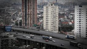Streetscape in Buenos Aires. Cars, traffic, day is ending stock video