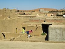 Typical architecture in Merzouga. Streetscape in Merzouga -Morocco with its typical buildings out of loam next to the desert Erg Chubby Stock Images