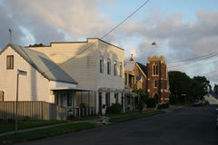 Streetscape in Stockton, Newcastle. Streetscape in Newcastle`s suburb of Stockton with old weatherboard houses and St Paul`s Anglican Church stock photo