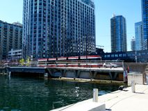 Streetscape and waterfront view in Toronto with modern condominium. Streetscape and waterfront view in Toronto, Canada with red and white streetcar and modern stock images