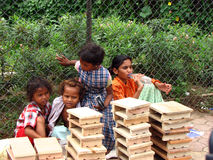 Streetside Indian Kids. Selling wooden ware Stock Photos