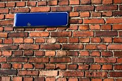 Streetsign. A brick wall with an empty streetsign Royalty Free Stock Photos