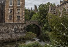 Streetsin Edinburgh - Dean Village. This image shows a view some trees and a buildings in Dean Village, Edinburgh. It was taken on a sunny day in summer 2018 stock photos
