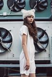 Cute girl in white dress and fur hat Stock Photos