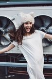 Happy teenager girl in white dress and fur hat Royalty Free Stock Photo