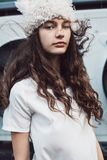Portrait of teenager girl in white fur hat Stock Images