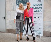 MILAN, Italy: September, 20 2018: Streetstyle outfits. Streetstyle outfits in Duomo square after GENNY fashion show during Milan fashion week fall/winter 2018/ stock images