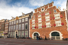 Streetview with colorful brick houses in Amsterdam Royalty Free Stock Photos