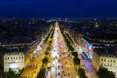 Streetview of famous Champs Elysees with illumination and traffic in Paris. PARIS, FRANCE - MAY 29: Evening streetview of famous Champs Elysees with illumination Stock Image