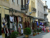 Streetview of outdoor shopping market with people walking in Athens, Greece Royalty Free Stock Photography