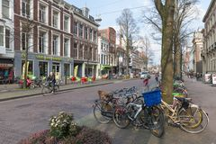 Streetview with parked bicycles in the old center of the Dutch governmental city The Hague. THE HAGUE, THE NETHERLANDS - MARCH 27: Streetview with parked Royalty Free Stock Photo