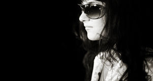 Streetwalker. Woman with big sunglasses with street reflection,black and white toned photo f/x Royalty Free Stock Images