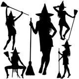 Strega di Halloween con le siluette del manico di scopa Fotografia Stock