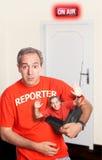 Streiche gespielter Reporter Stockbilder