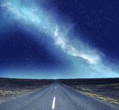 Streight road under the clear night sky stock image