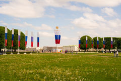 Strelka Vasilyevskogo Ostrova, Saint Petersburg Russia. Strelka Vasilyevskogo Ostrova, Saint Petersburg, Russia with flags on poles on sunny day Stock Photo