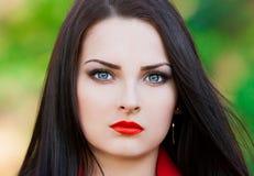 Strelnikova_Svetlana. Woman face, blue contact lenses, red lips! royalty free stock photo