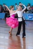 Strelskiy Aleksander och Ratomskaya Anna Perform Juvenile-1 latin - amerikanskt program Arkivbild