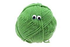 Streng van wol met ogen Royalty-vrije Stock Afbeeldingen