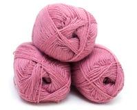 Strengen van een roze wol Stock Foto's