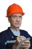 Strenger Auftragnehmer auf einer Baustelle stockbild