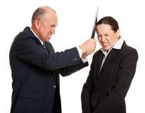 Strenger Leiter und junge Arbeitskraft Lizenzfreie Stockbilder