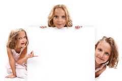 Strenght of three. Smiling happy 7 years old girl look outs from the empty banner. Collage Stock Photo