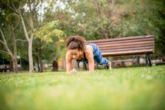 Strenght training in forests. Young woman on strenght training in public park Royalty Free Stock Image