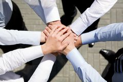 Strength. Above view of business partners hands on top of each other symbolizing companionship and unity Royalty Free Stock Image