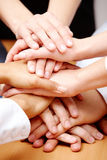 Strength. Image of business partners hands on top of each other symbolizing companionship and unity royalty free stock photos