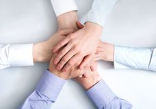 Strength. Above view of business partners hands on top of each other symbolizing companionship and unity Royalty Free Stock Photo