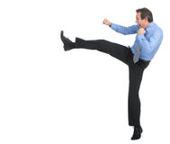 Strength and authority. Full length of angry businessman imitating a fight standing against white background royalty free stock photography
