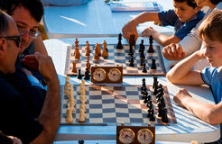 Strength of the brain. Two chess match during the Festival of Sport in 2009 at the Porto Antico di Genova royalty free stock image