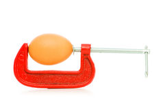 Strength concept with egg and clamp Royalty Free Stock Photos