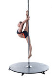Strength and grace of pole dance. Cute girl posing Stock Photography