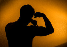 Strength - Silhouette of man Stock Photo