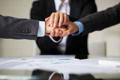Strength. Image of business partners hands on top of each other symbolizing companionship and unity Royalty Free Stock Photography