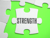 Strength - Jigsaw Puzzle with Missing Pieces. Bright Green Background. Close-up. 3d Illustration Stock Photo
