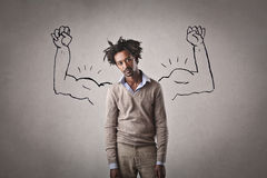 Strength. A man pretending to be strong Royalty Free Stock Image