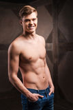 Strength and masculinity. Handsome young muscular man posing while standing against metal background Royalty Free Stock Photos
