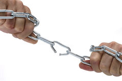 Strength. Metal chain being forced open by the strength of a man's hands Royalty Free Stock Photo