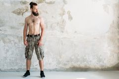 Strength power workout bare chested fit man stand royalty free stock photos